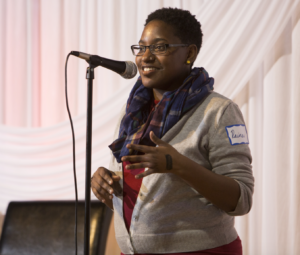 Raina Johnson telling a story at an event