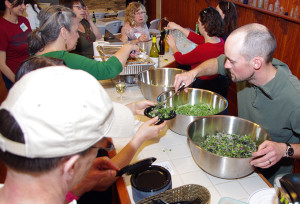 Ryan serves up microgreens; photo by Elizabeth Dawson.