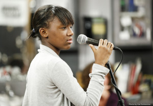 young girl talks into a mic