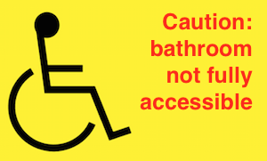 wheelchair caution sign: bathroom not fully accessible
