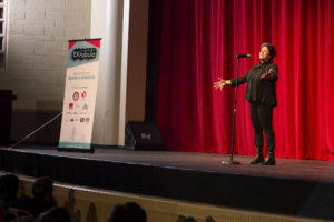 Magda Peck shares a story on stage