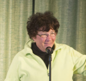 Sandy, who has short curly dark hair and glasses, tells her story.