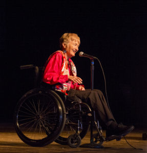 Barbara, in her wheelchair, tells her story.