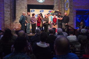 "Storytellers at ""First Time"" StorySlam on stage"