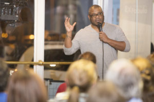 Carl McCorkle sharing a story onstage at Garfield's 502