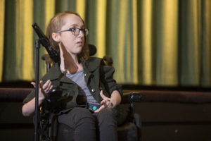 Emily Jamar telling a story at Times Cinema