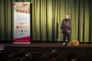 "Older woman with guide dog sharing a story on stage at Times Cinema for ""Last Straw"""