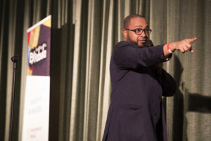 """Eugene Pitchford pointing to the audience while telling his """"Last Straw"""" story at Times Cinema"""